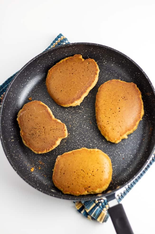 Vegan pancakes in nonstick pan