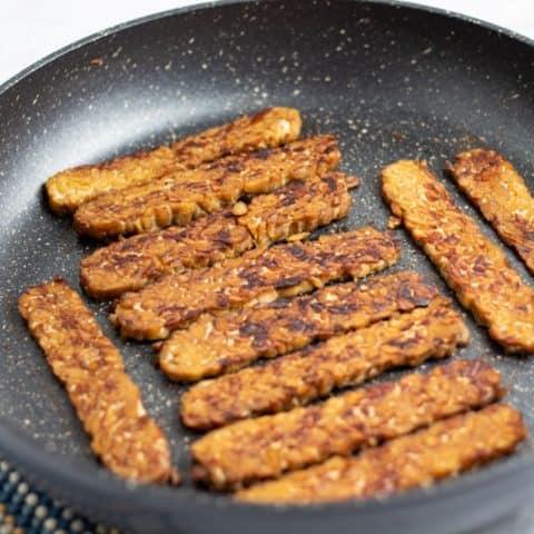 smoked tempeh bacon in non stick pan