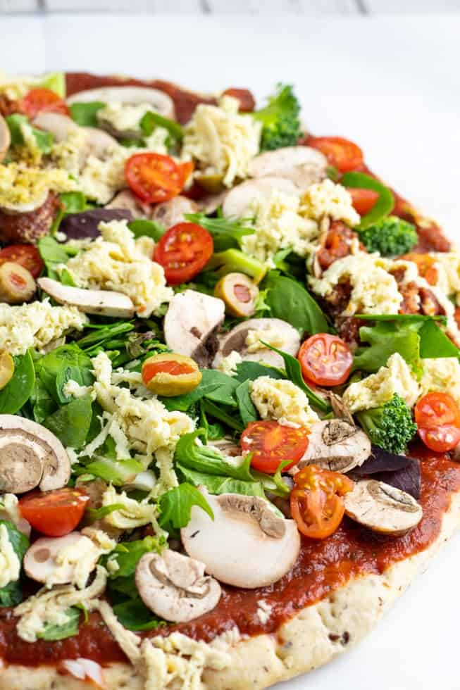 veggie pizza loaded with toppings on background