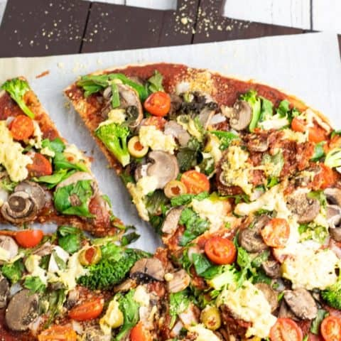 overhead photo of veggie pizza on cutting board