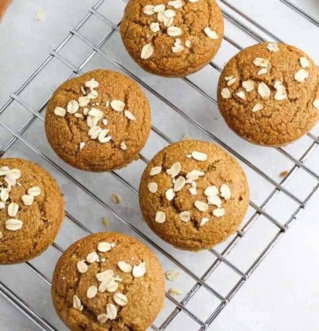 banana oat flour muffins on cooling rack