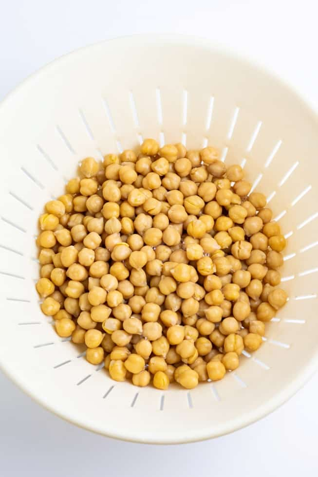 chickpeas being drained white background