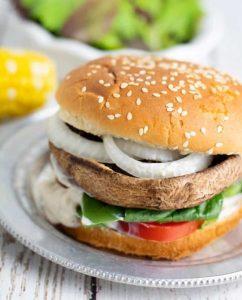 portobello mushroom on bun with onion, lettuce, tomato