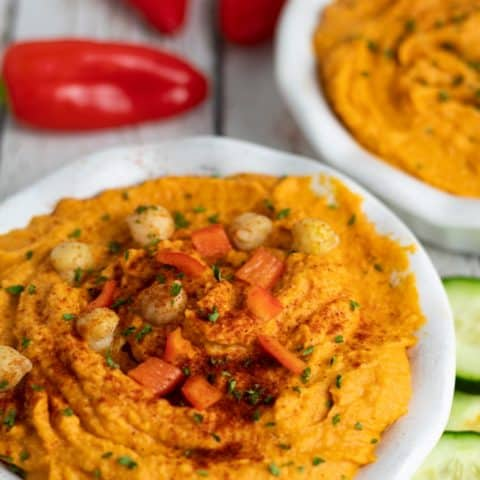roasted red pepper hummus in white bowls