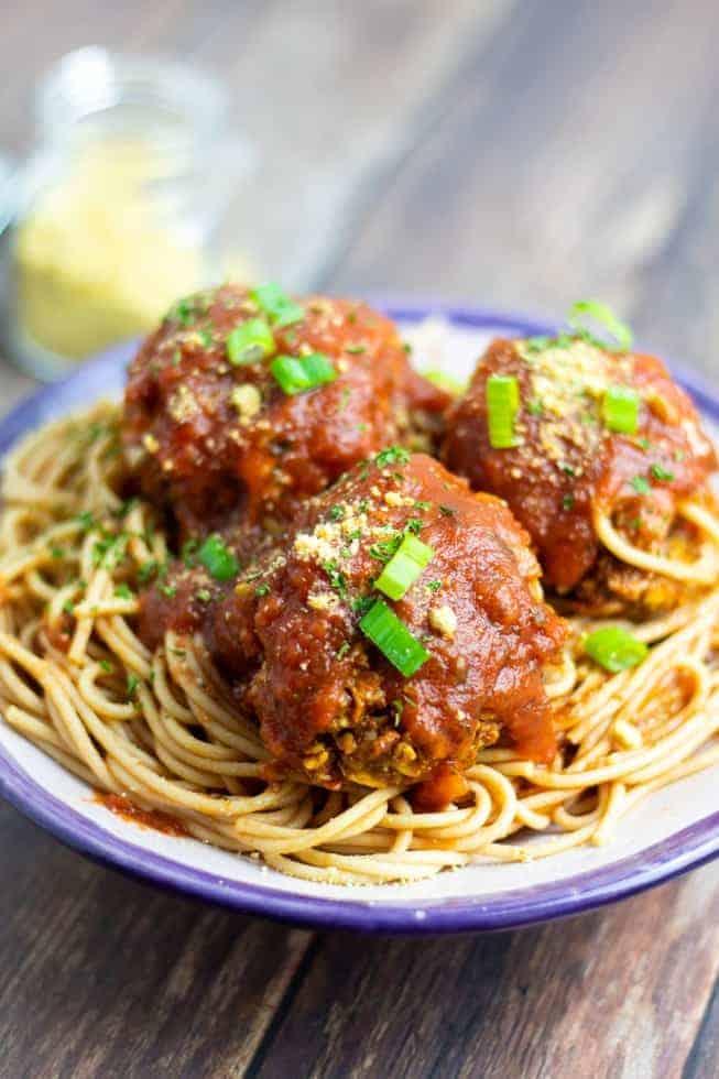 vegan spaghetti & meatballs in bowl on wooden table