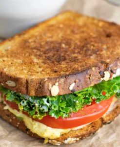 vegan grilled cheese sandwich with tomato and lettuce