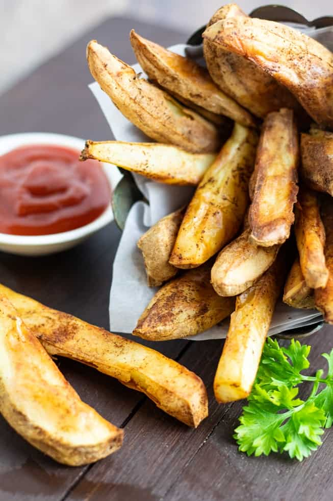 oil free fries with ketchup on dark wooden table