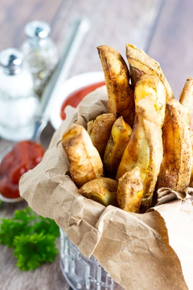 air fryer french fries wrapped in brown paper in glass
