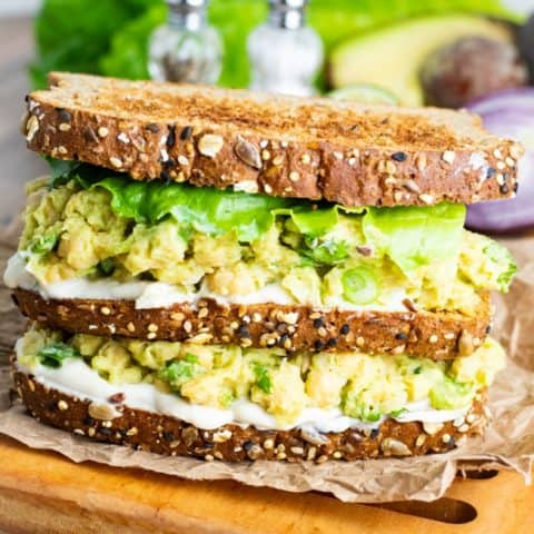 Chickpea Avocado Salad sandwich stacked on cutting board