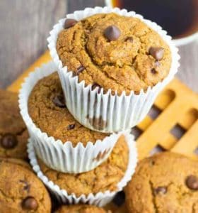 dairy free chocolate chip muffins in white paper cups stacked up