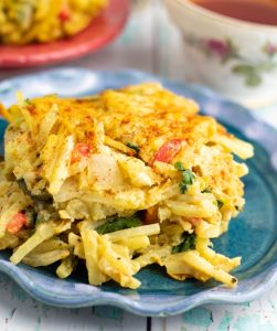 hash brown breakfast casserole on blue plate close up