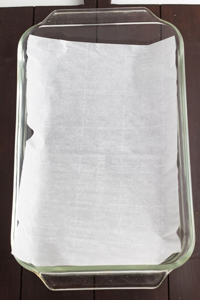 parchment paper lining an empty casserole dish