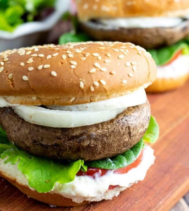 portobello burgers on cutting board