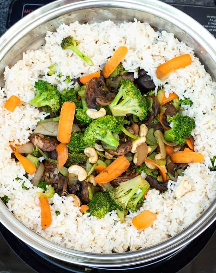 asian stir fry with rice in pan