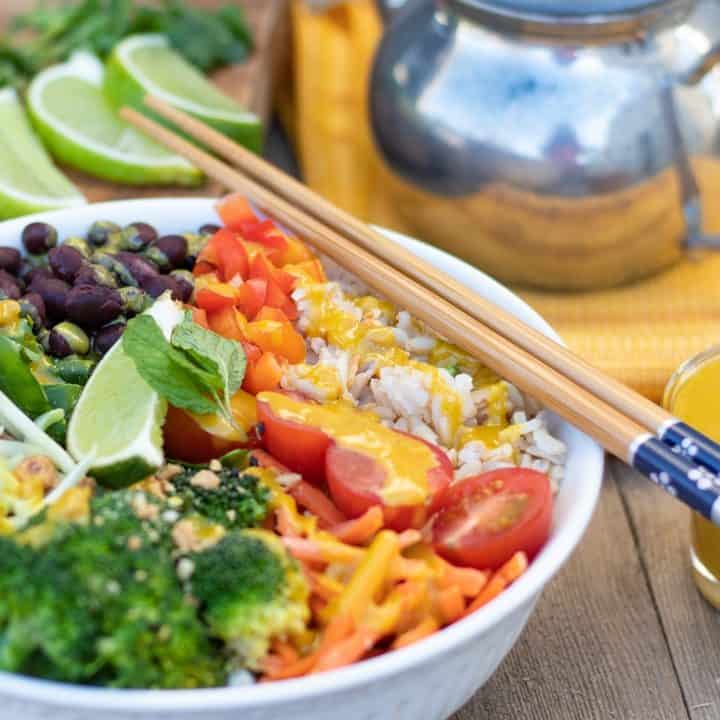 veggie bowl with rice and tahini sauce and chopsticks