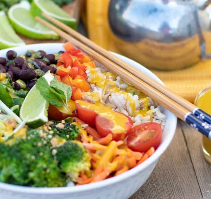 veggie bowl with rice and tahini sauce and chopsticks