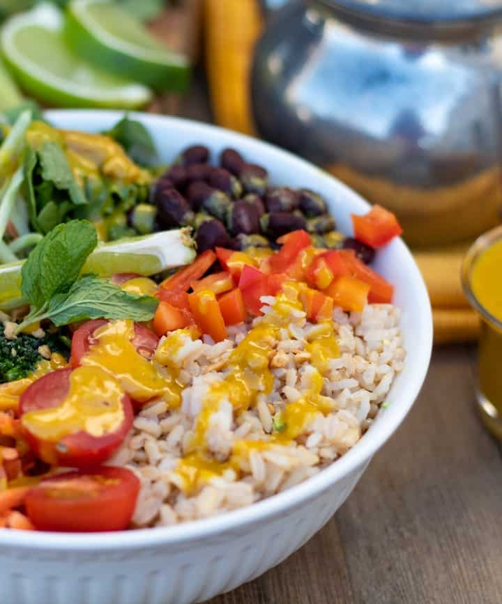 colorful bowl full of vegetables and rice