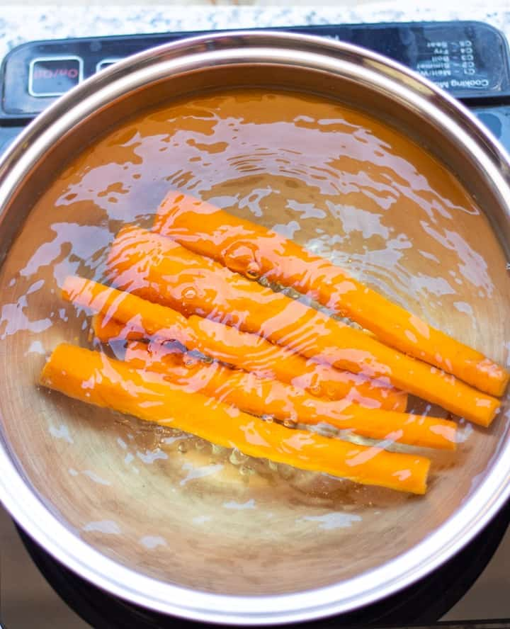 carrots boiling in stainless pan