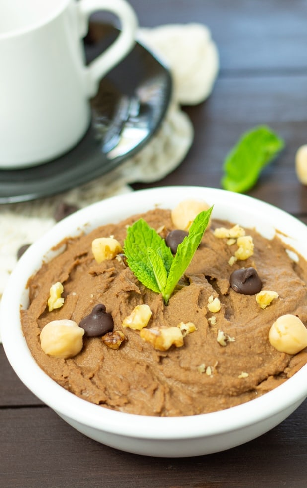 chocolate hummus topped with chickpeas and chocolate chips in white bowl