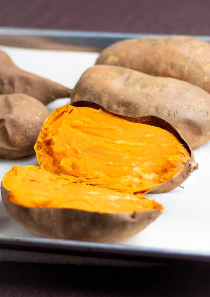 sliced sweet potatoes on baking pan