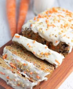 vegan carrot cake loaf with 3 pieces sliced
