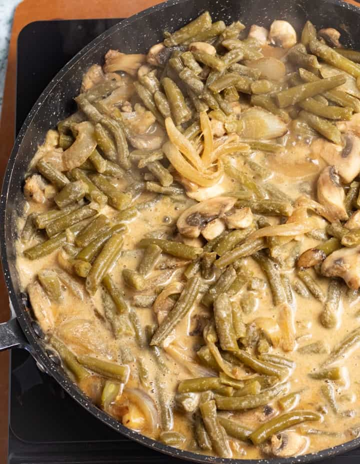green beans, onions, and mushroom soup in fry pan