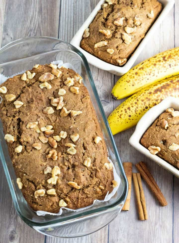overhead shot of banana bread topped with walnuts in baking pan
