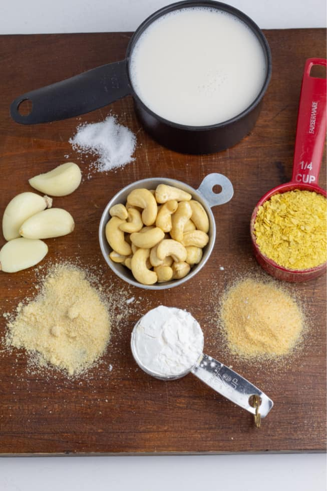 ingredients plant milk, cashews, spices on wooden board