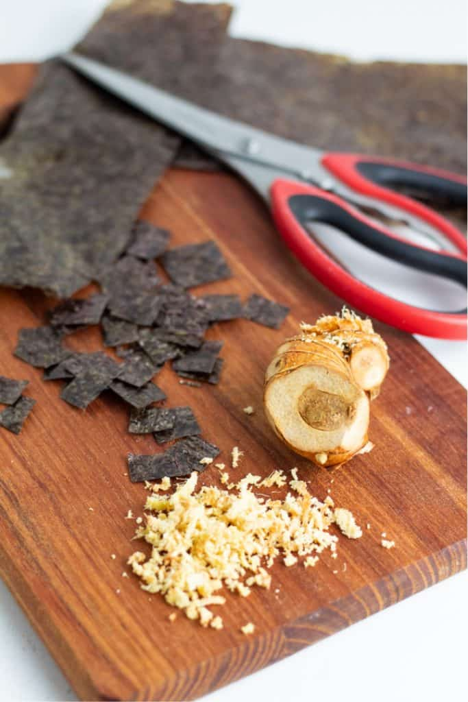 grated ginger on cutting board with nori