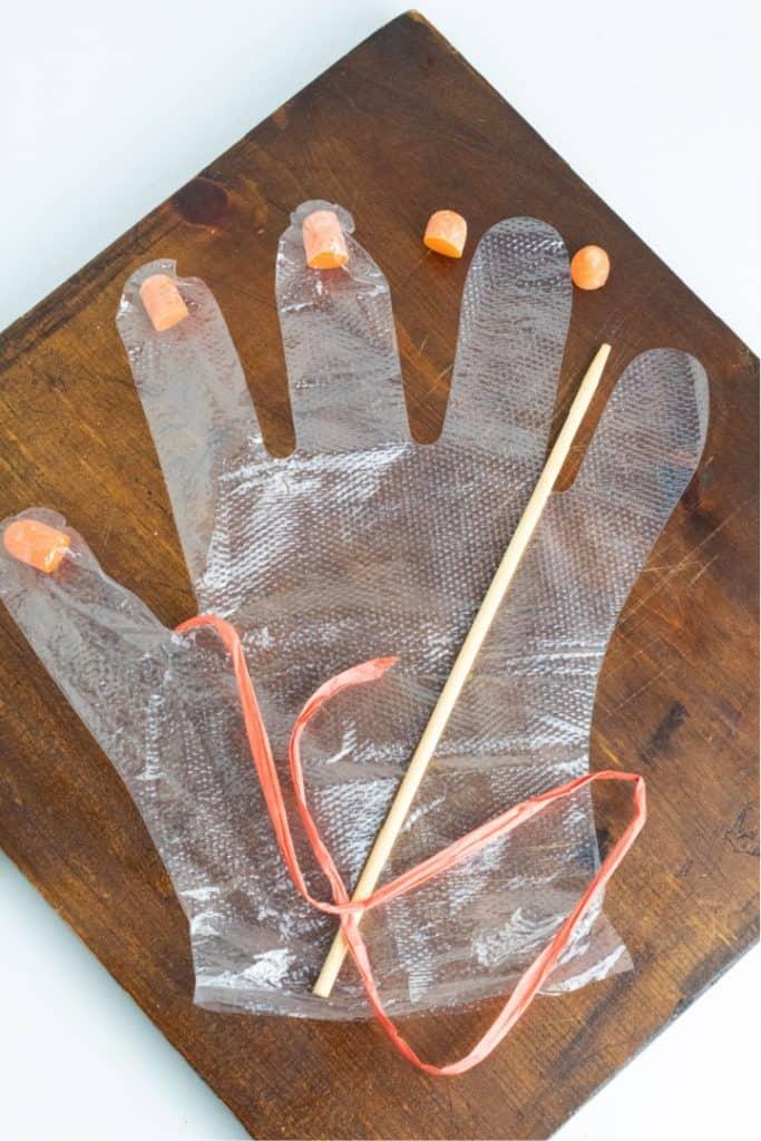clear plastic glove on brown wood board