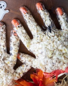 halloween popcorn hands with spider ring on one finger
