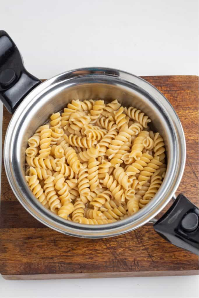 whole wheat spiral pasta cooked in stainless saucepan
