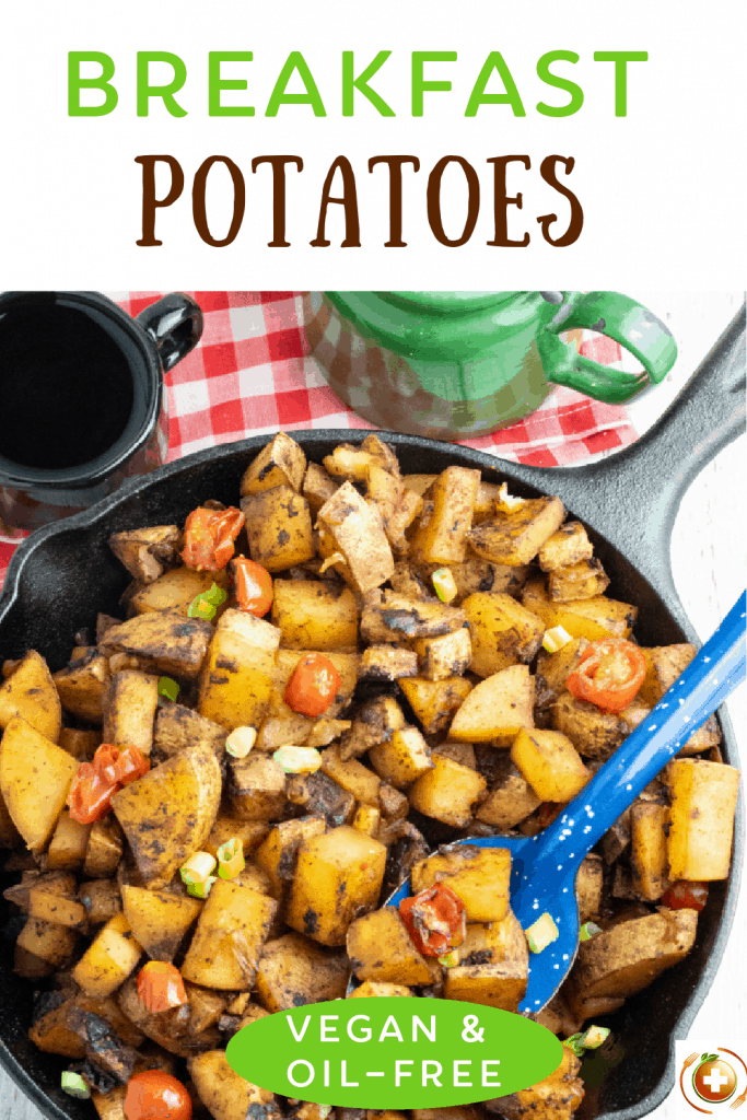 cooked breakfast potatoes in cast iron skillet with bright blue spoo