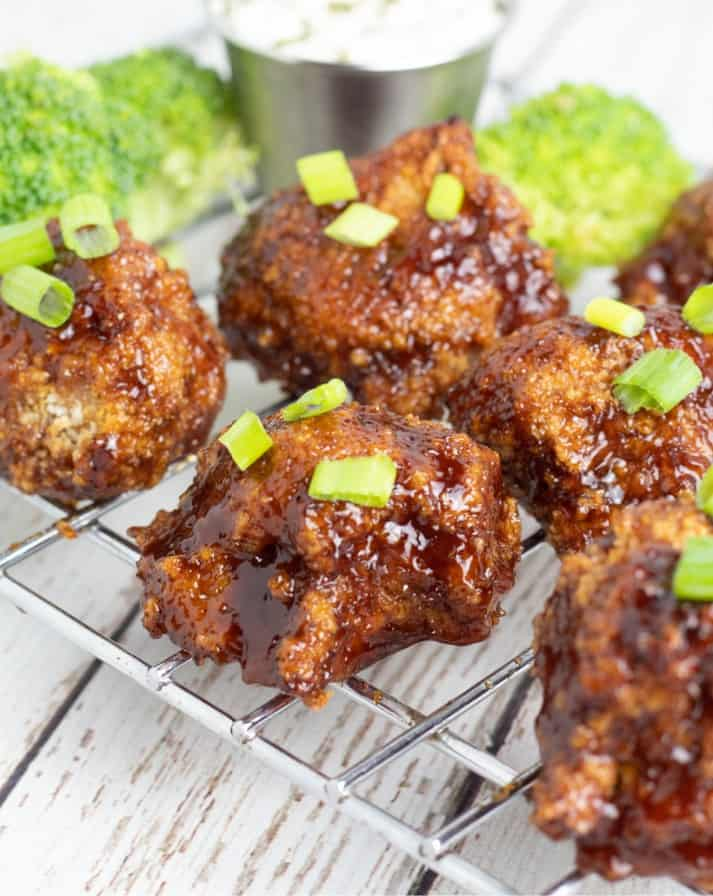 cauliflower wings with bbq sauce on cooling rack