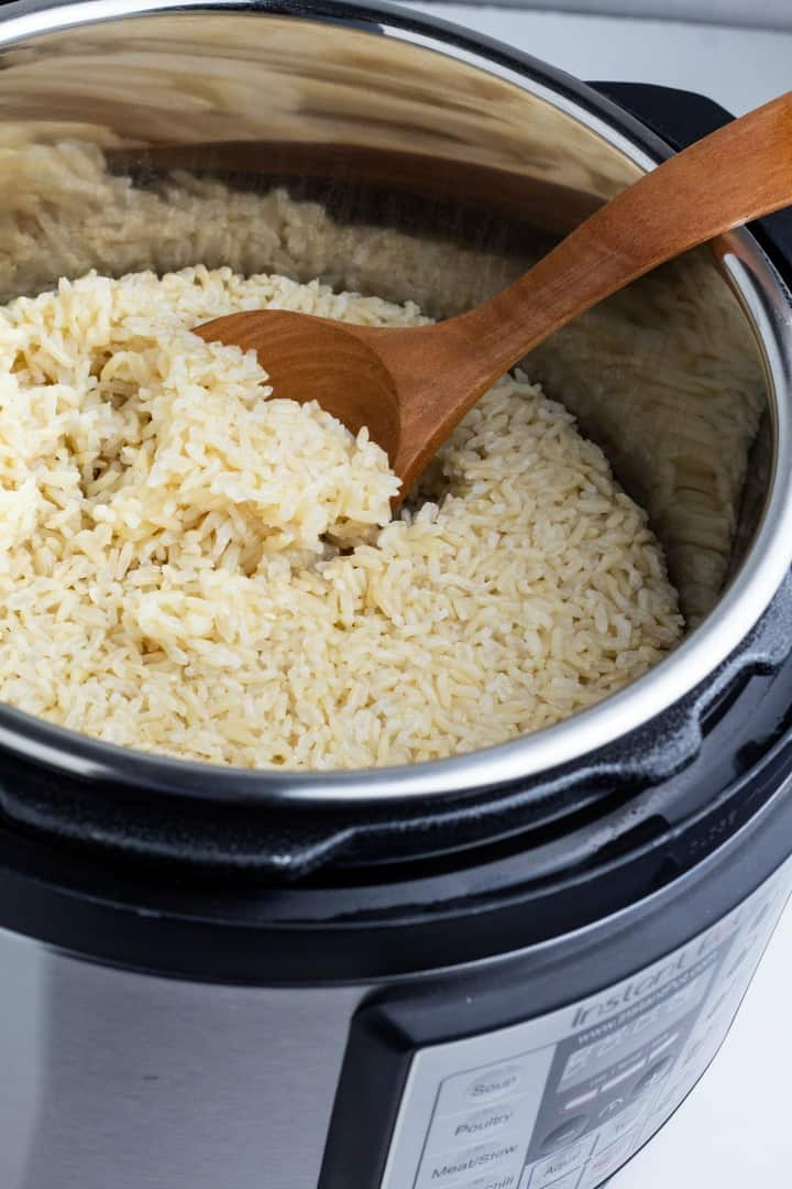 brown rice cooked in instant pot with wooden spoon