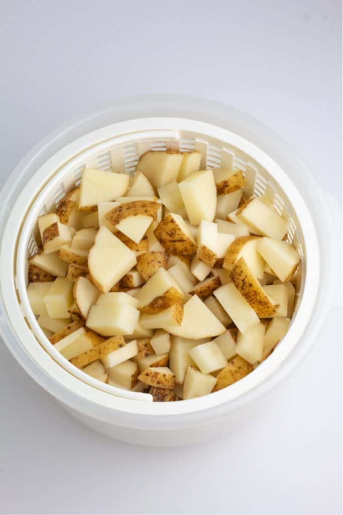diced potatoes in white basket steamer