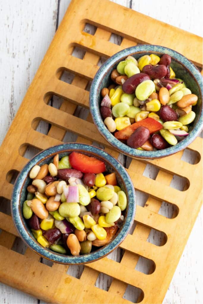 overhead photo of 3 bean salad in 2 blue bowls