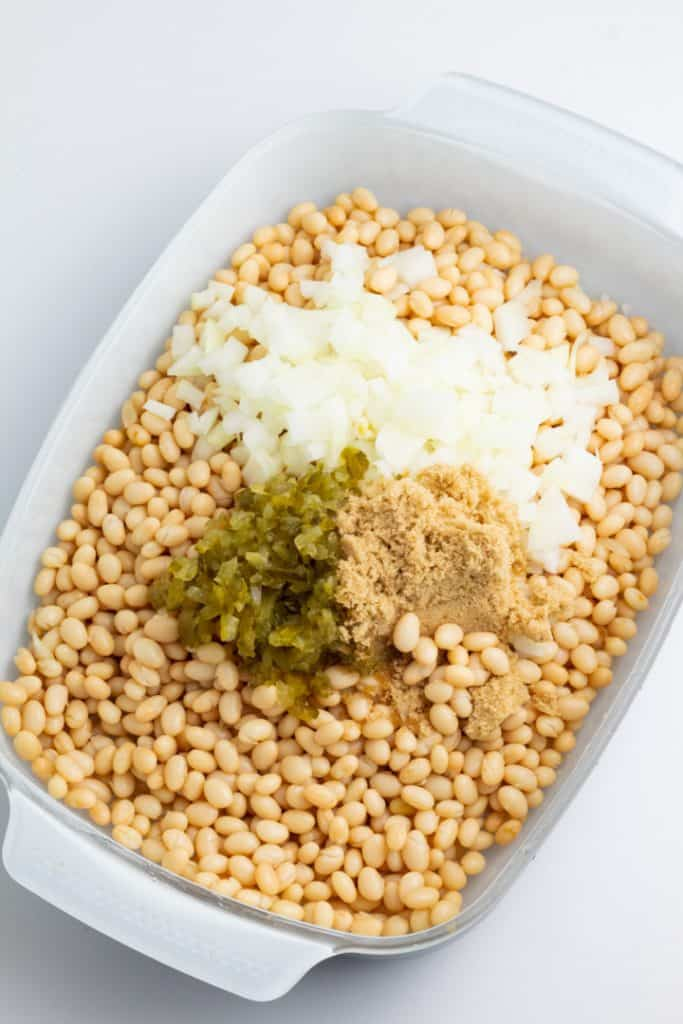 casserole dish with beans, onion, relish, and brown sugar