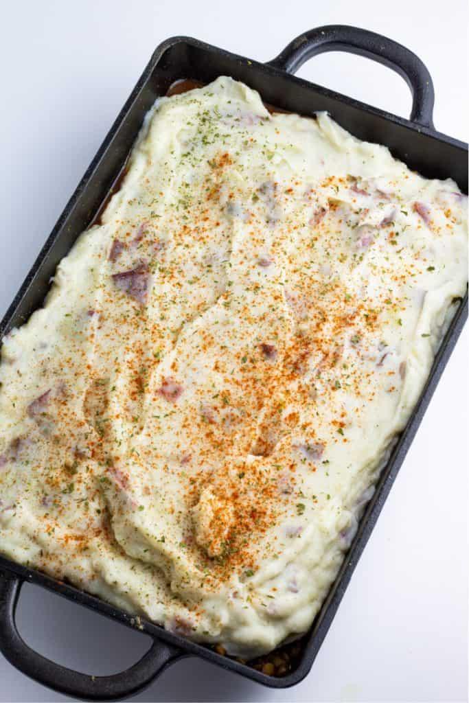 cast iron casserole pan with lentil cottage pie
