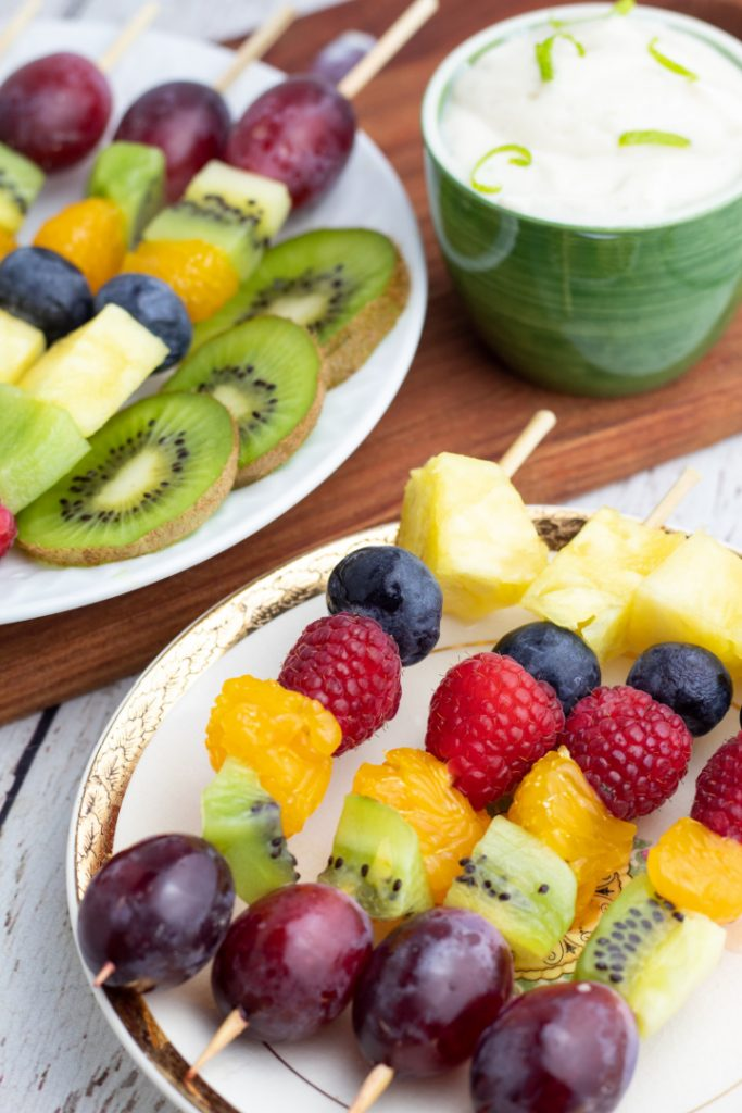 fruit skewers on two plates