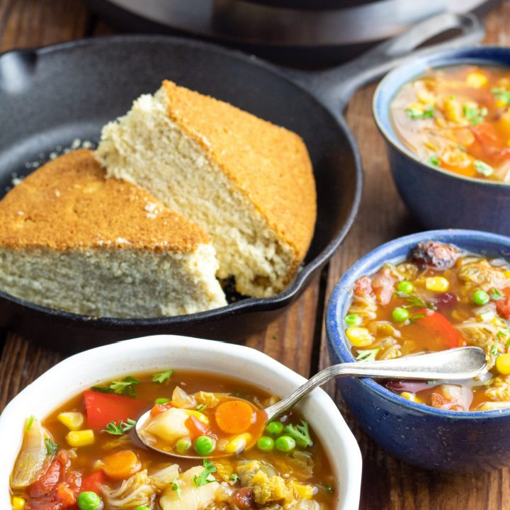 3 bowls of vegetable soup with instant pot and cornbread in background