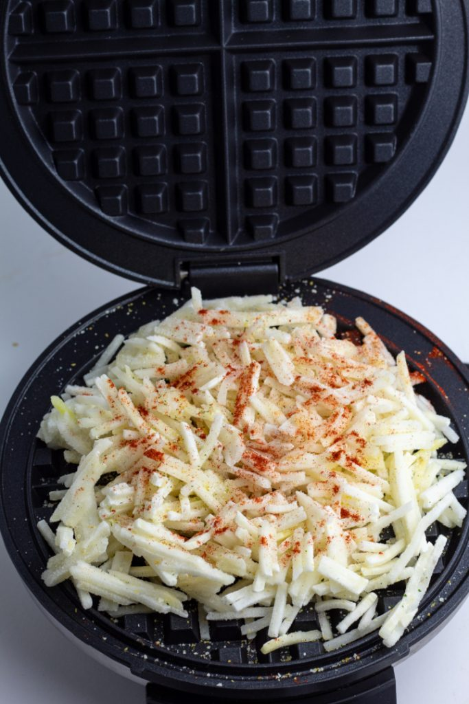 frozen hash brown in black waffle iron
