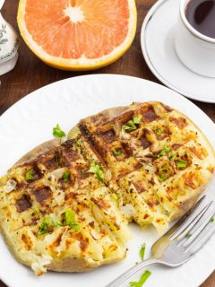 waffle potato cooked in white plate with fork
