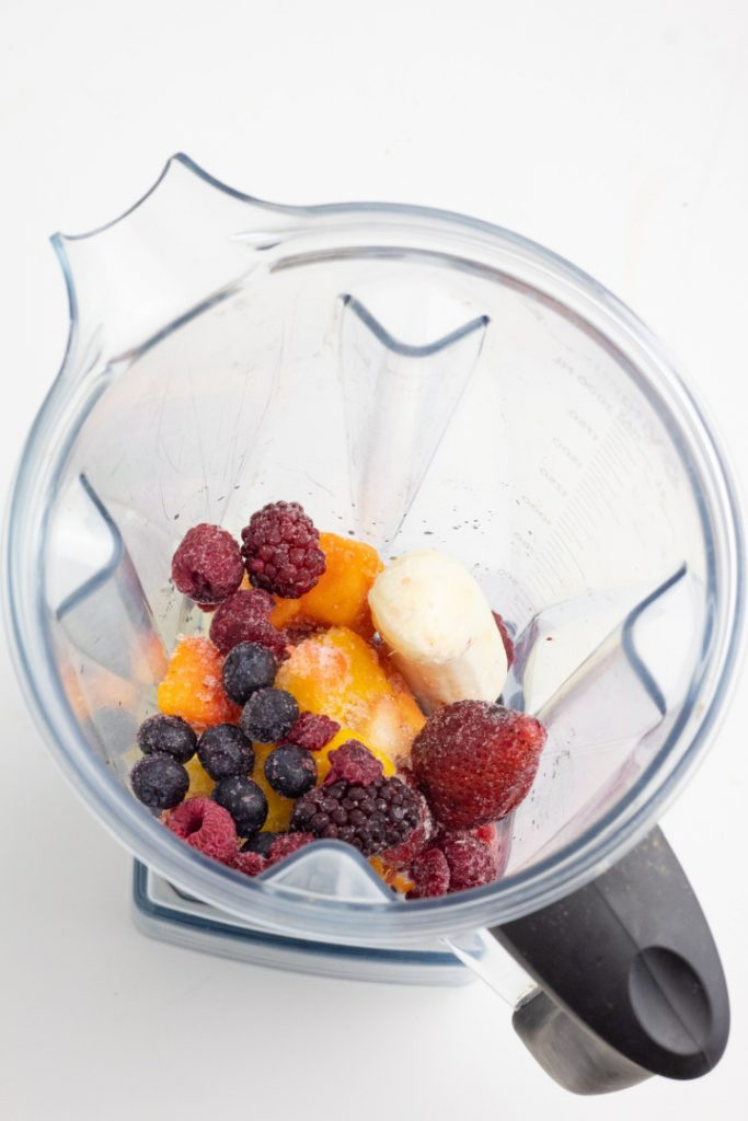 frozen berries and fruit with banana in blender