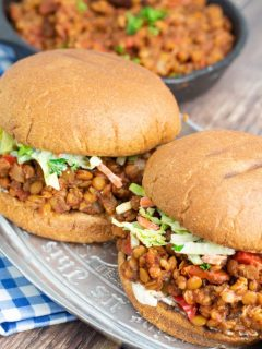 two lentil sloppy joes on whole wheat buns on plater