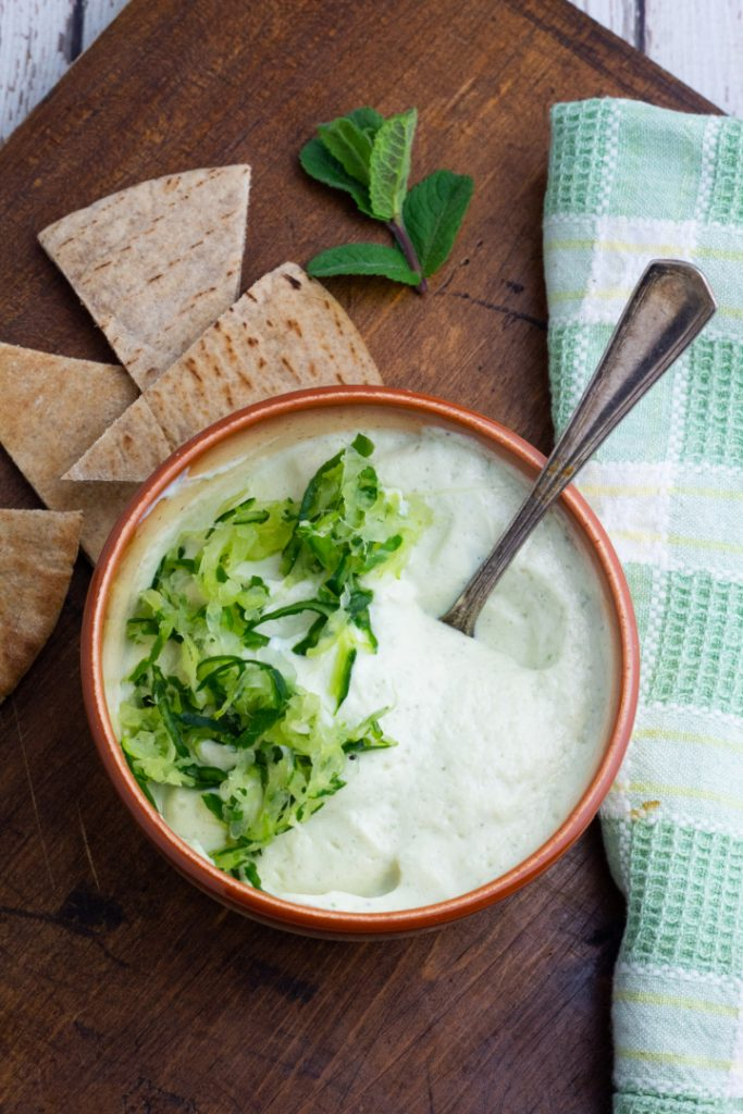 bowl with tzatziki sauce and grated cucumbers