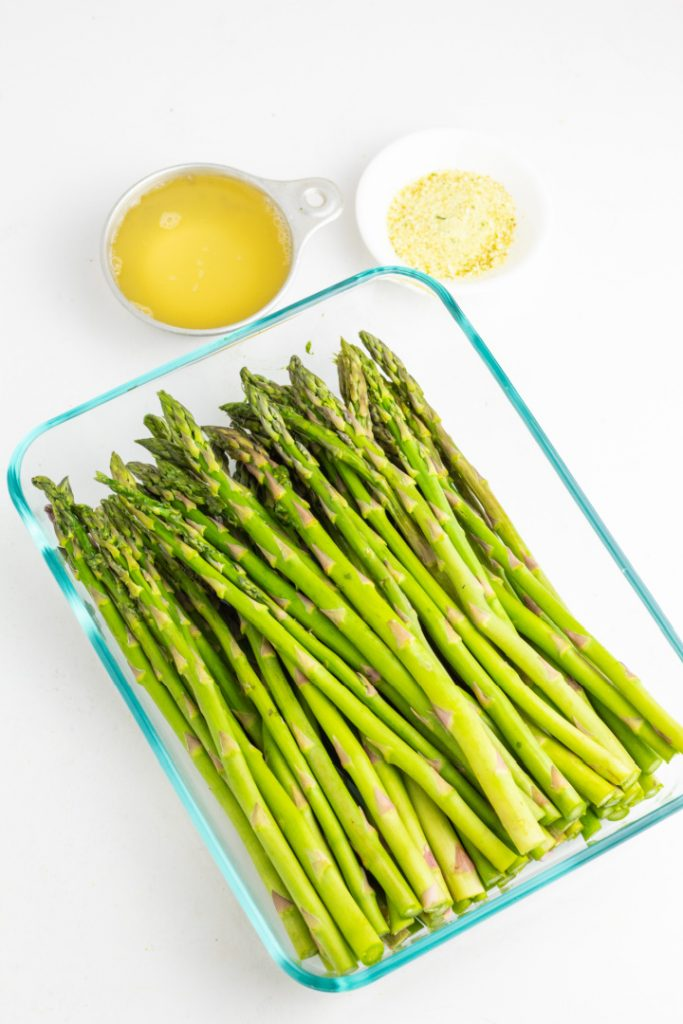 glass rectangular dish with asparagus and spices