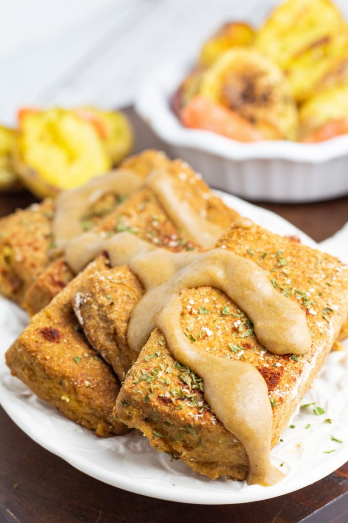 baked tofu slices topped with vegan gravy