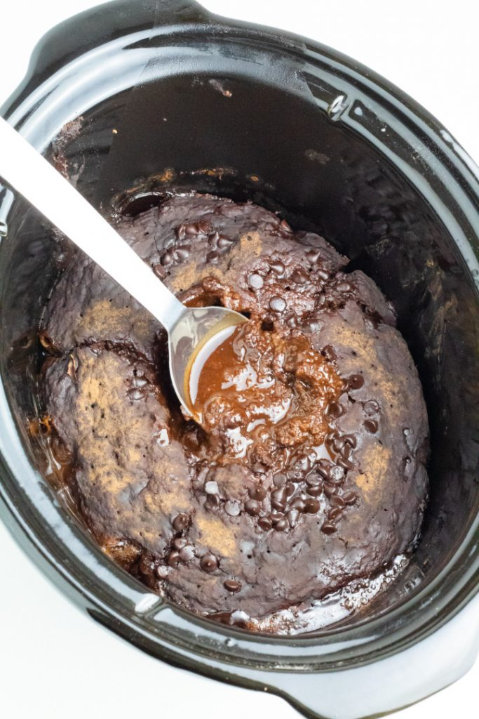 crockpot filled with choco lava cake and large spoon
