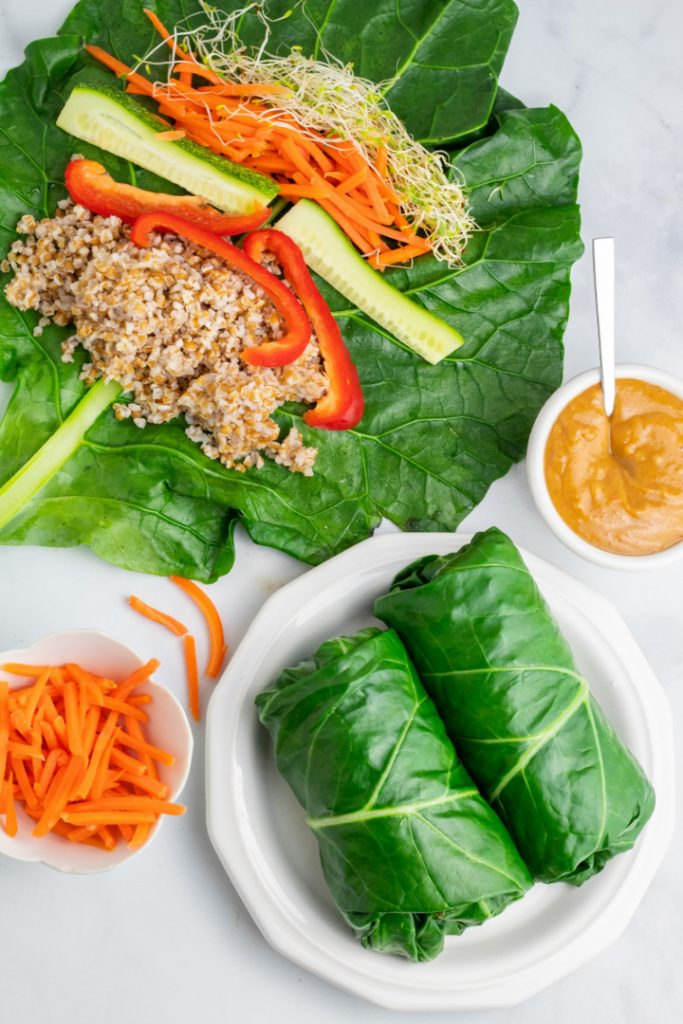 overhead photo of 2 whole vegan wraps made with collard leaves